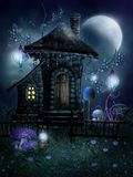 Fairy cottage with lamps Stock Images