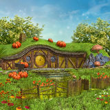 Fairy cottage with pumpkins Stock Images