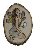Fairy with Crystal Sphere. Illustraton of fairy with crystal, on basswood plaque, done with woodburning technique known as pyrography Stock Photos