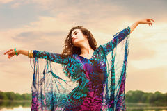 Fairy dance. Young woman in colorful dress dance in nature summer day small amount of grain added Royalty Free Stock Photo