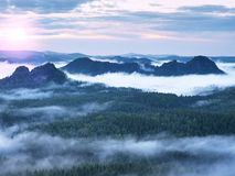 Fairy daybreak in a beautiful hilly landscape Stock Photo