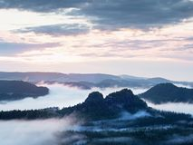 Fairy daybreak in a beautiful hilly landscape Stock Photos