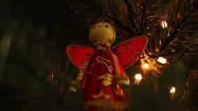 Fairy decoration on Christmas tree with Christmas bokeh lights.  stock footage