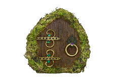 Fairy door with moss on isolated background Royalty Free Stock Photography