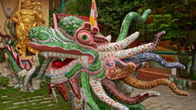 Fairy Dragon Sculpture Made of Colorful Tile Pieces in Park stock footage