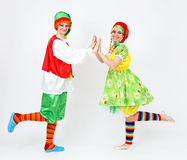 Fairy dwarf girl and her elf friend on white Stock Photos