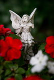 Fairy Figurine Among Flowers Royalty Free Stock Photo