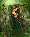 The Way To Fairyland. A fairy flies into the fairyland! The Fairyland is located behind a door in the forest Royalty Free Stock Photography