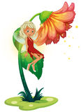 A fairy floating near the giant flower Stock Images