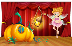 Fairy flying around pumpkin house on stage Royalty Free Stock Images