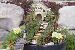 Fairy garden in a flower pot outdoors Royalty Free Stock Images