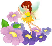 A fairy at the garden with fresh flowers Royalty Free Stock Photo