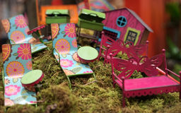 Fairy garden patio furniture. Bright colors make these tiny faerie garden furniture pieces and outdoor decor fun Stock Photo