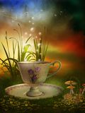 Fairy garden with a porcelain cup Royalty Free Stock Photo