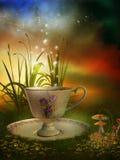 Fairy garden with a porcelain cup. Magic garden with a porcelain cup, mushroom and flowers Royalty Free Stock Photo