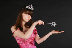 Fairy girl. Fairy with a magic wand conjures Royalty Free Stock Photo
