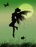 Fairy girl. Sweet fairy flying to moon with butterfly Royalty Free Stock Photography