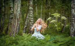 Fairy girl in a forest. Fairy girl with smart hair in the forest Royalty Free Stock Photo
