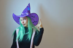 Fairy girl - gnome, dummy, good fairy, witch for Halloween. Woman in a purple hat with green hair (good or evil witch Royalty Free Stock Photo