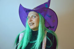 Fairy girl - gnome, dummy, good fairy, witch for Halloween. Woman in a purple hat with green hair (good or evil witch Stock Image