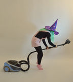 Fairy girl - gnome, dummy, good fairy, witch for Halloween. Woman in a purple hat with green hair (good or evil witch Stock Photography