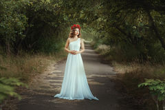 Fairy girl standing on the road in woods. Royalty Free Stock Image