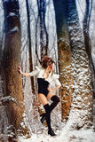 Fairy girl in winter forest among the trees Royalty Free Stock Photography