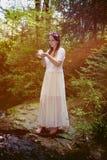 Fairy with glass ball Stock Photos