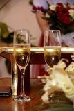 Fairy glasses are full of sparkling champagne during the wedding royalty free stock photo