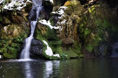 Fairy glen waterfall. In mid winter Royalty Free Stock Photography