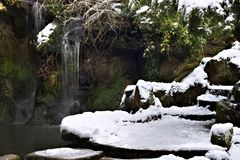 Fairy glen waterfall. In mid winter Royalty Free Stock Image