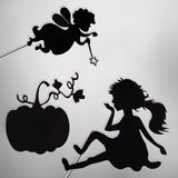 Fairy Godmother, Cinderella and Pumpkin shadow puppets Royalty Free Stock Image