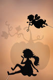 Fairy Godmother and Cinderella shadow puppet and the pumpkin shade Royalty Free Stock Photography