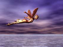 Fairy Golden. Golden fairy flying over the sea Stock Image