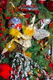 Fairy holding Christmas ornament below spaceman ornament on eclectic holiday tree. A Fairy holding Christmas ornament below spaceman ornament on eclectic holiday Stock Image