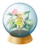 A fairy holding a flower inside the crystal ball Royalty Free Stock Images