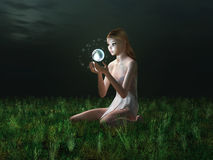 Fairy holding glowing sphere. Little fairy holding glowing sphere Royalty Free Stock Photos
