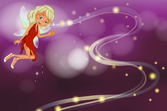 A fairy holding a sparkling wand Royalty Free Stock Image