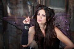 Fairy Holds a Cigar Stock Photo