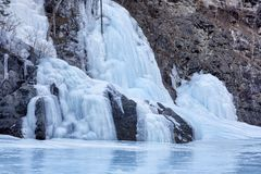 Fairy icefall is result of freezing of small falling streams. At negative ambient temperatures. Formation of bizarre forms of frozen spring water royalty free stock image