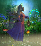 Fairy Laryn. Flies through the misty forest in the evening holding a bright lantern to light her way Stock Photos