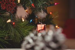 Fairy light and small gift box hanging on christmas tree Stock Photo