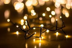 Fairy lights for the Christmas tree with blurry background royalty free stock photos
