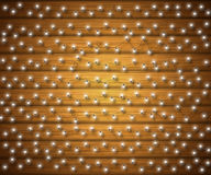 Fairy lights for festive decoration. Glowing Christmas garland, wood texture. Fairy lights for festive decoration, realistic luminous bulbs. Colourful glowing Royalty Free Stock Photos