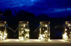 Fairy lights inside retro vintage screw top jars with handles Stock Photography