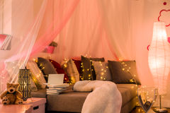 Fairy lights in teen bedroom. Fairy lights and baldachin in teen bedroom Royalty Free Stock Photography