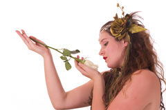 Fairy looking at white rose Royalty Free Stock Photography