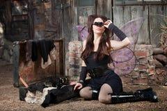 Fairy Looks Through Loupe Stock Photo