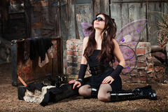 Fairy With Loupe Glasses Looks Up Royalty Free Stock Image