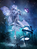 Fairy with magic flute Stock Photography